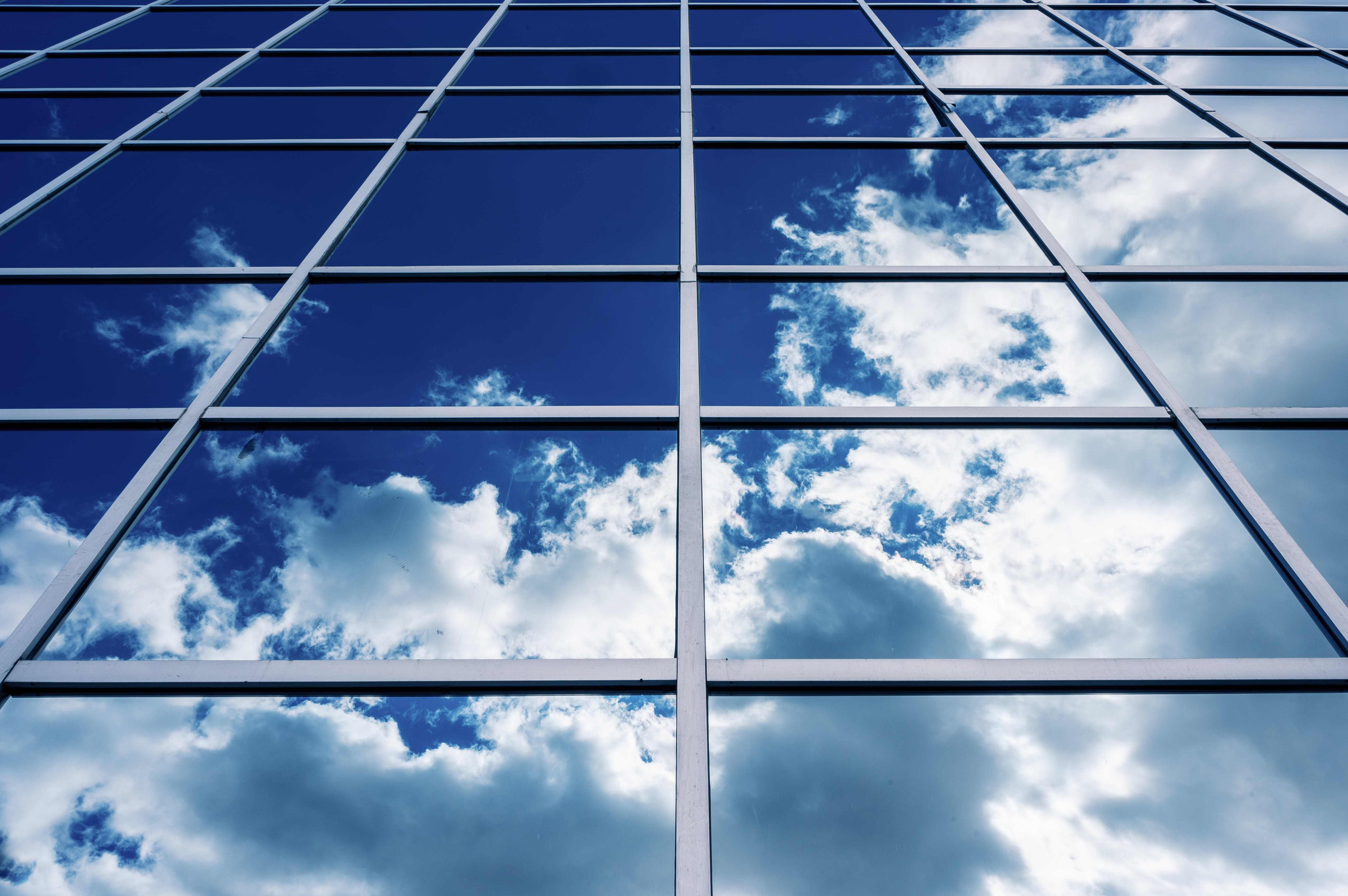 Glass Building With Clouds Reflection