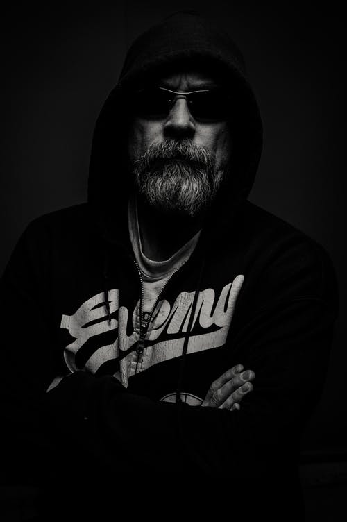 Grayscale Photography of Man Wearing Hooded Jacket