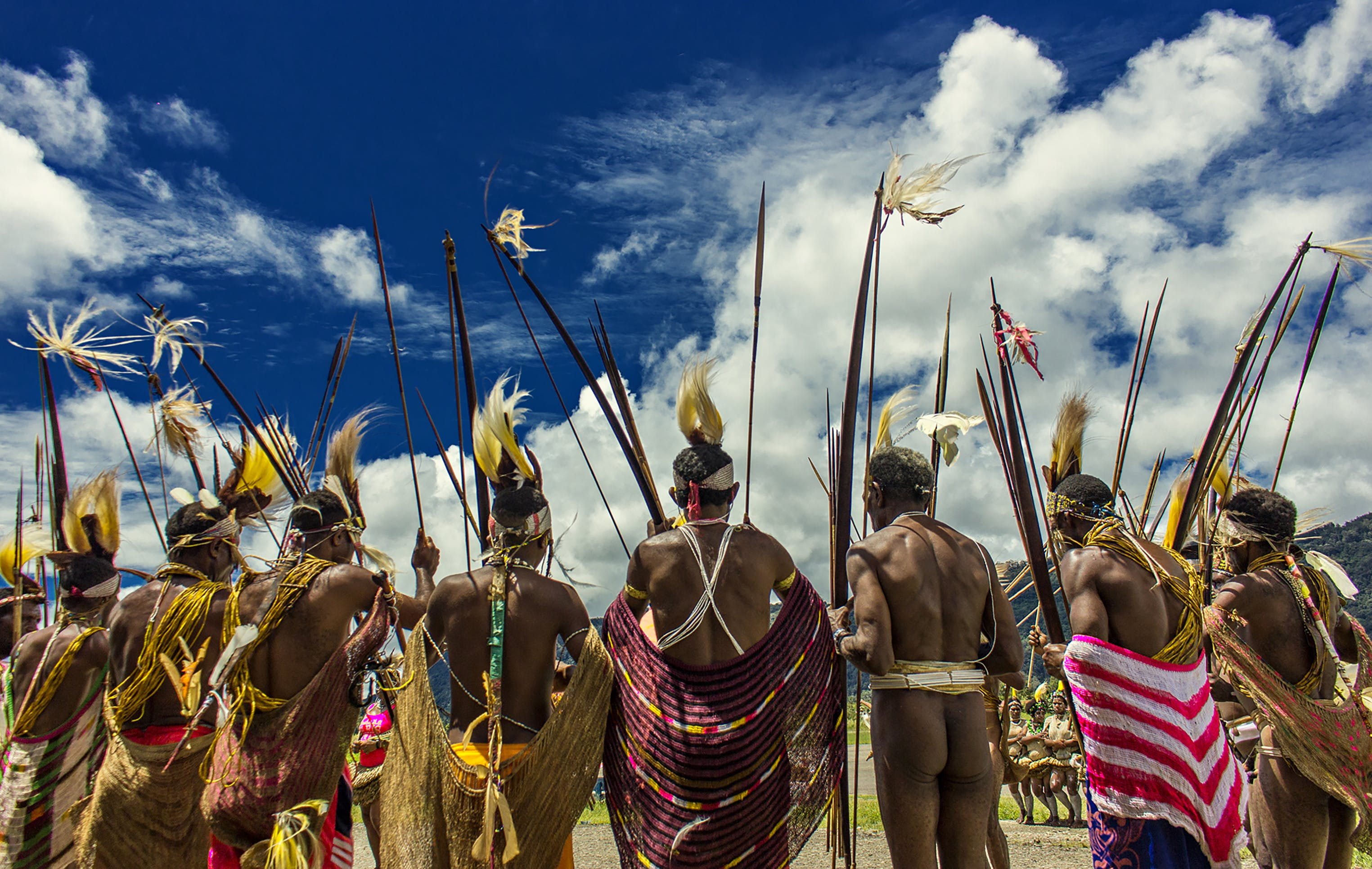 Men Wearing Tribal Costumes during Day