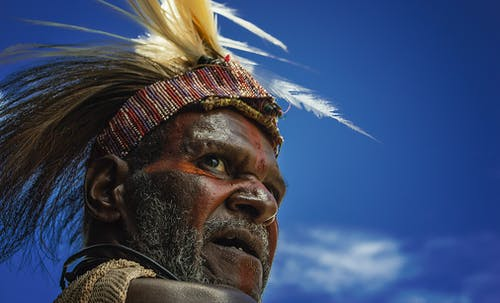 Photography of Man in Feather Headband