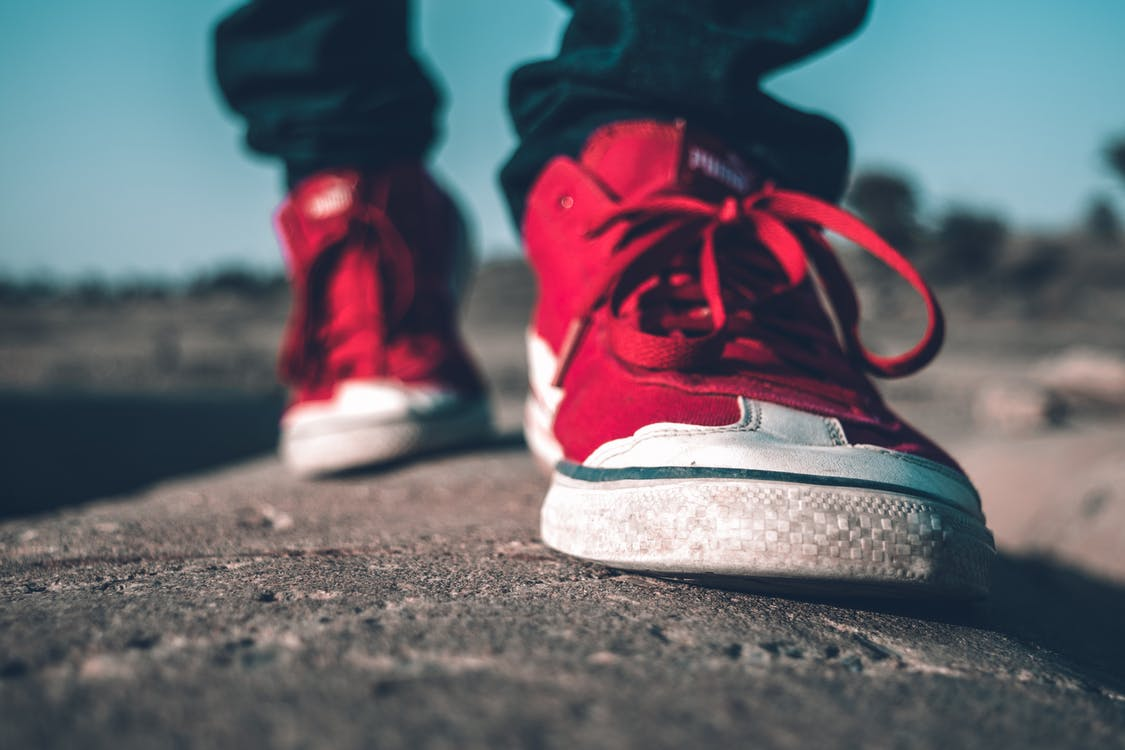 Photo of Person Wearing Red Shoes