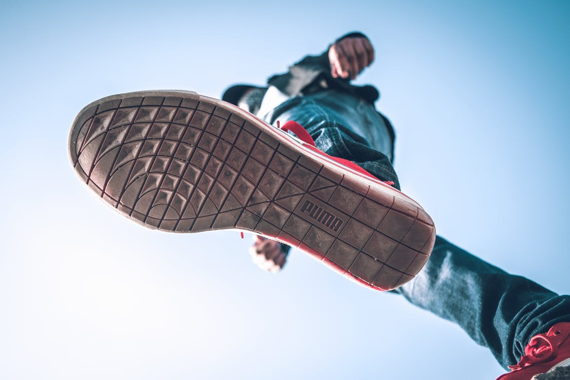 Person Wearing Puma Shoe