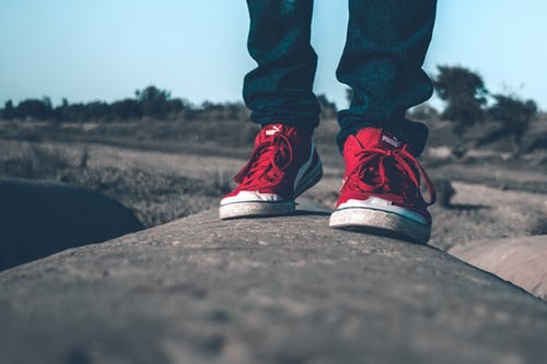 Person Wearing Red Shoes