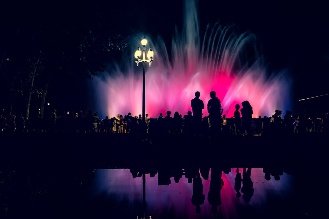 Silhouette Of People Near Fountain
