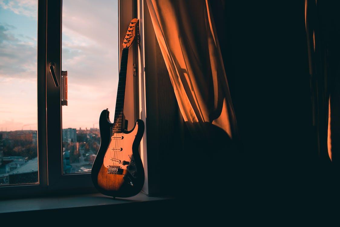 Guitar Beside Window