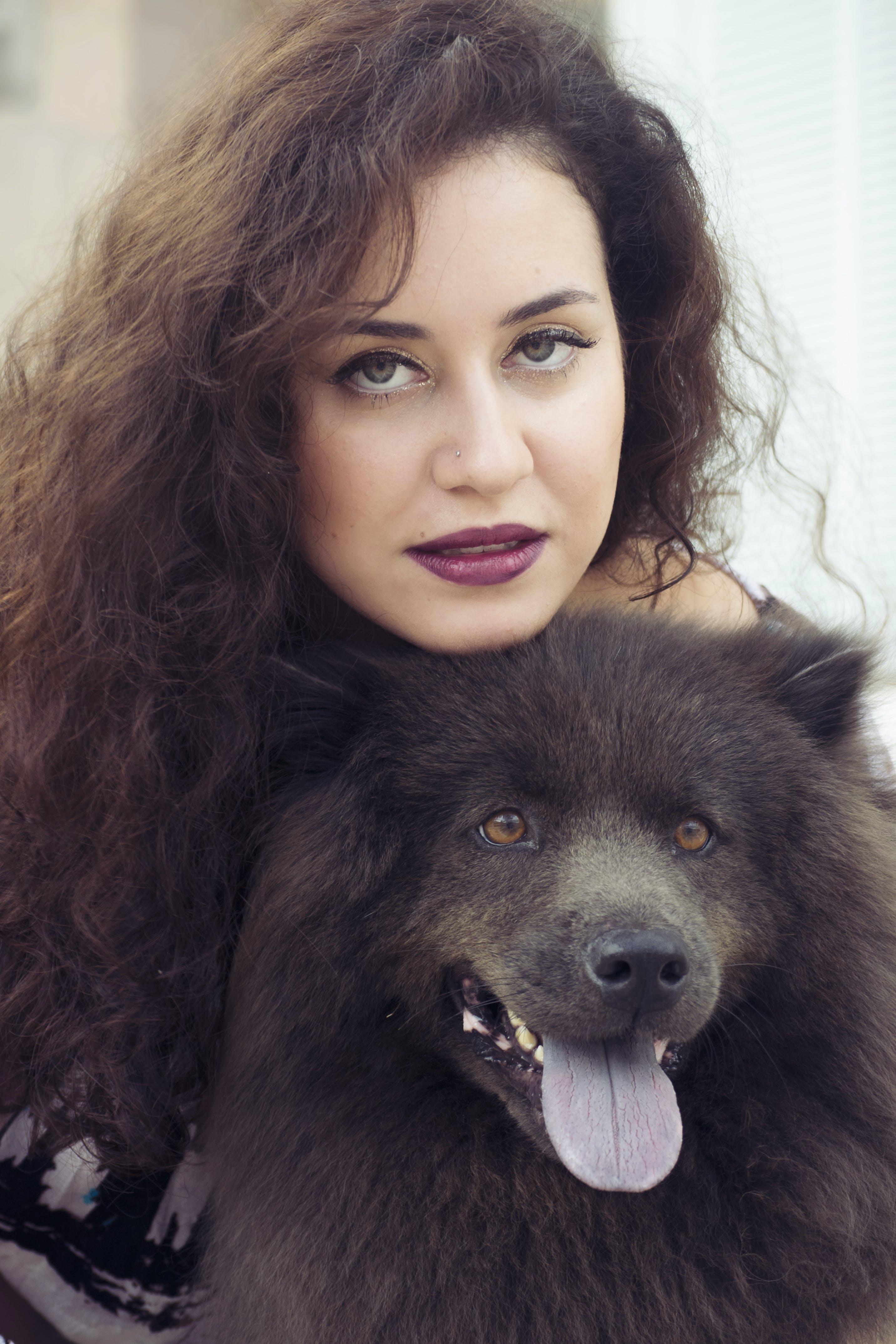 Woman Holding Black Dog