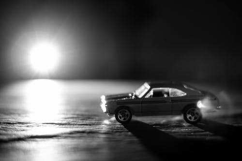 Grayscale Photo of Coupe Diecast