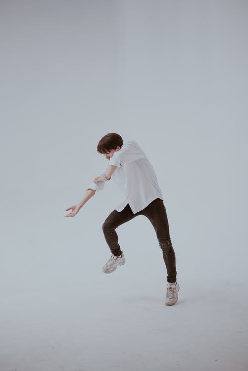 Dancing Man in White Room