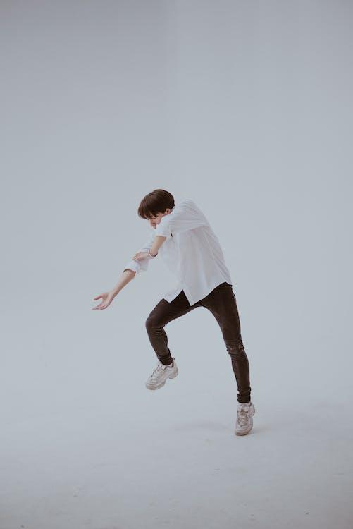 Dancing Man in White Room