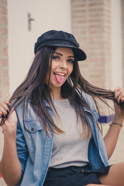 Woman With Black Hat And Blue Denim Jacket