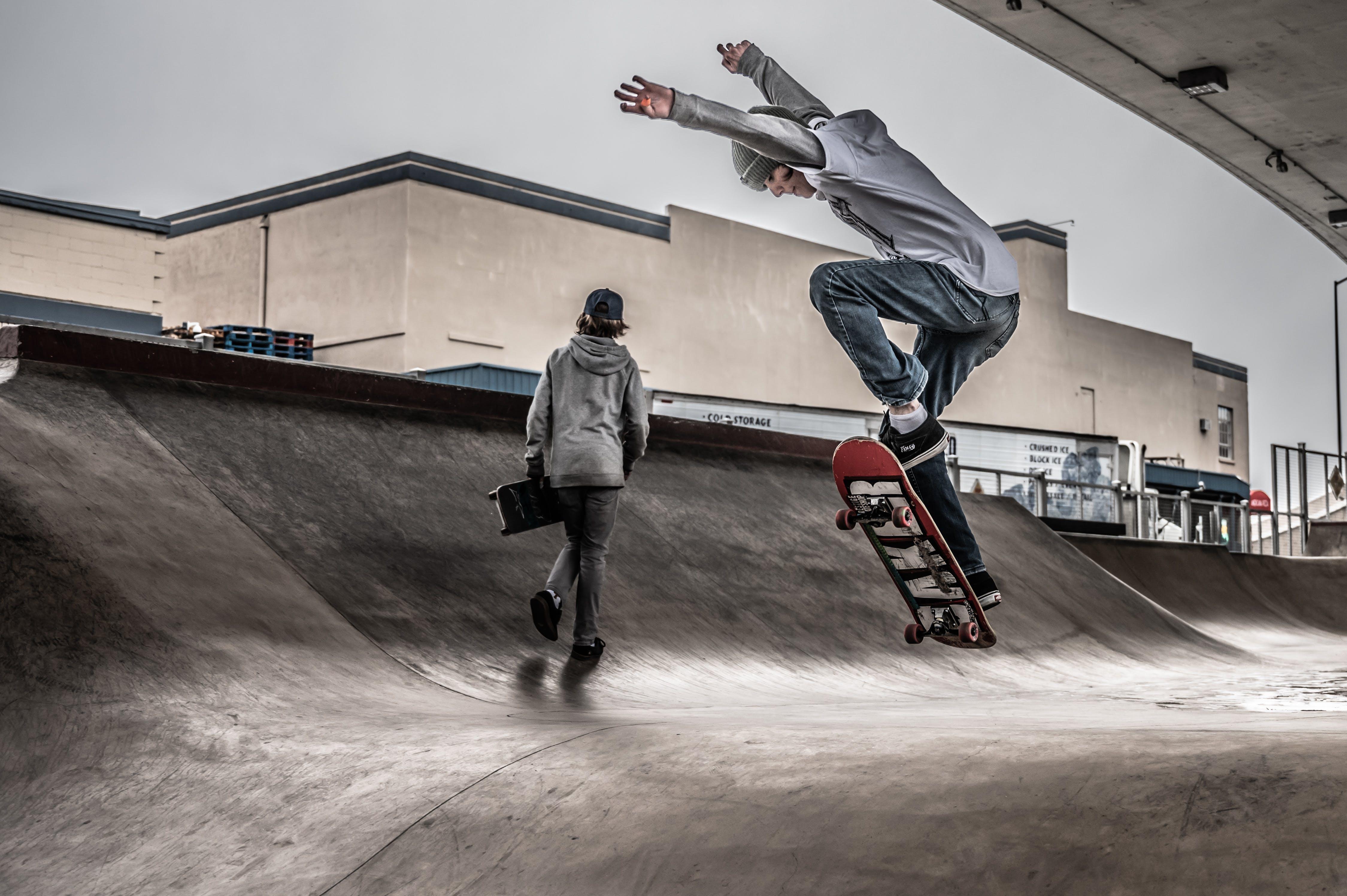 Two Men On Skate Park