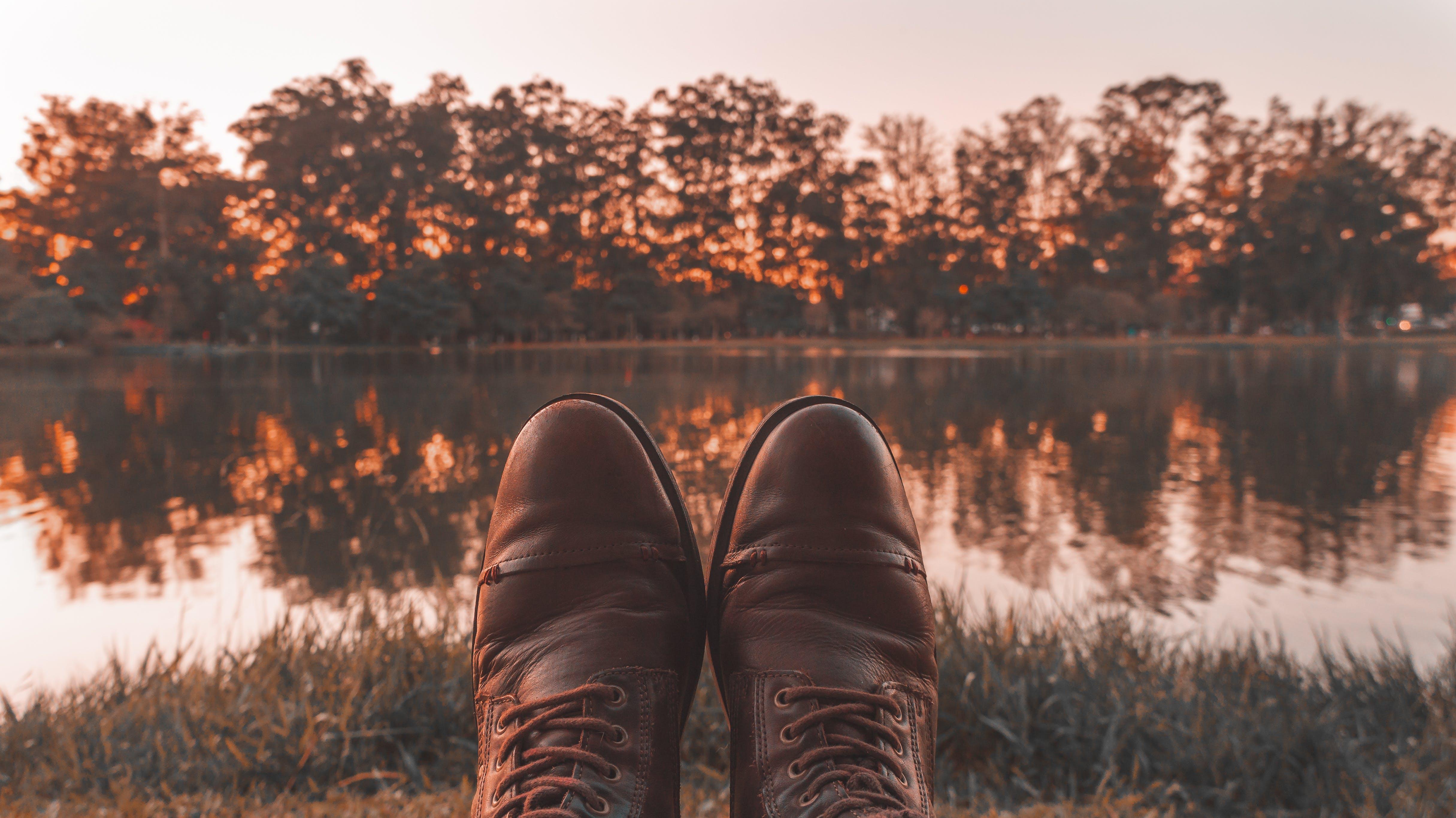 Free stock photo of evening sun, lagoon, leather boots