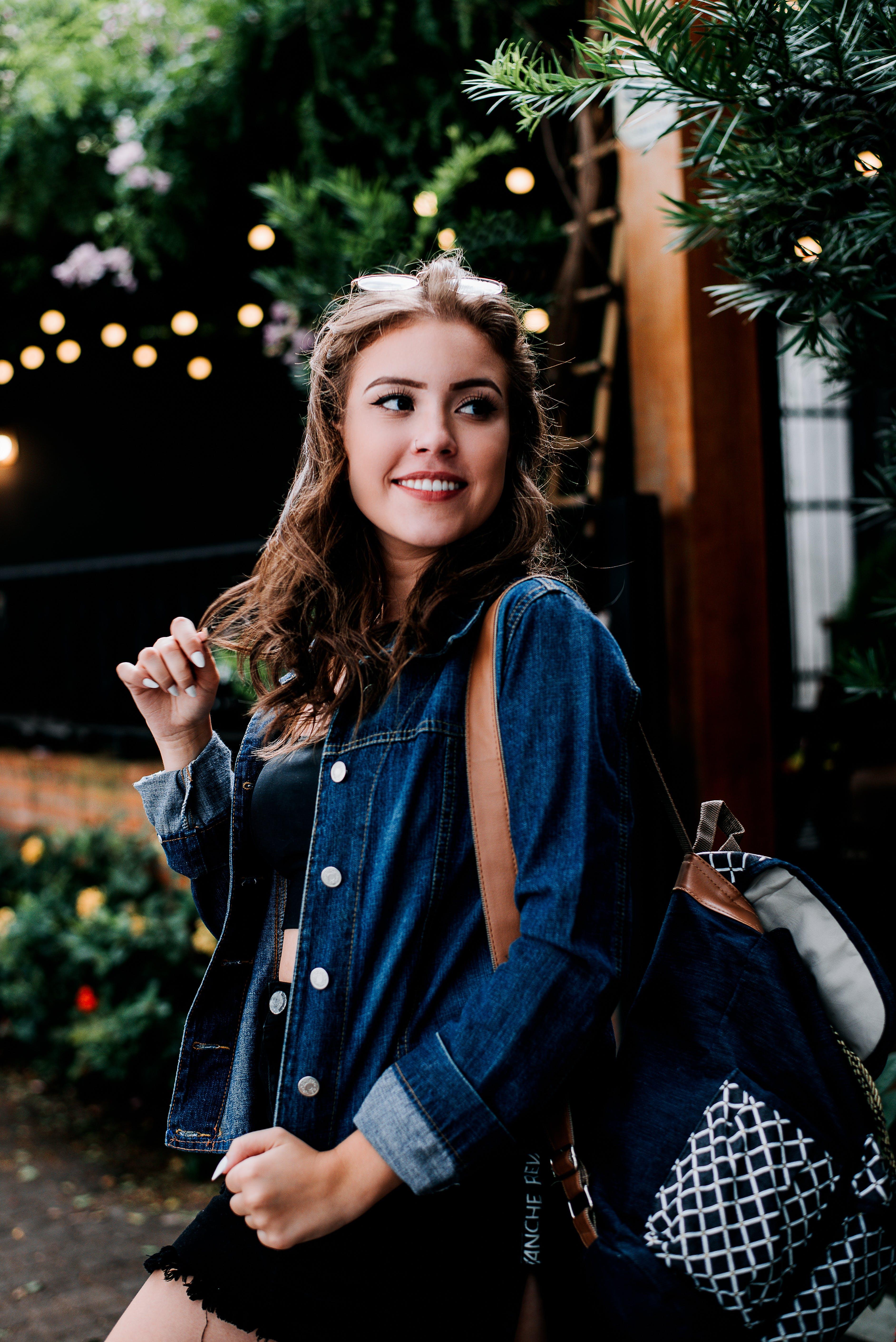Woman Wearing Blue Denim Jacket