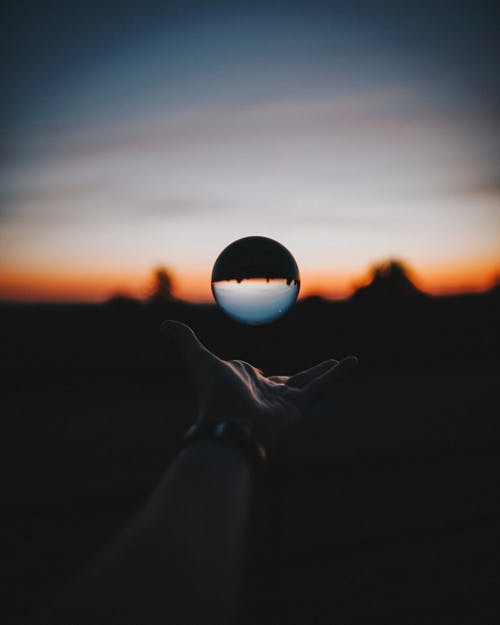 Force Perspective Photography of Sphere Glass during Sunset