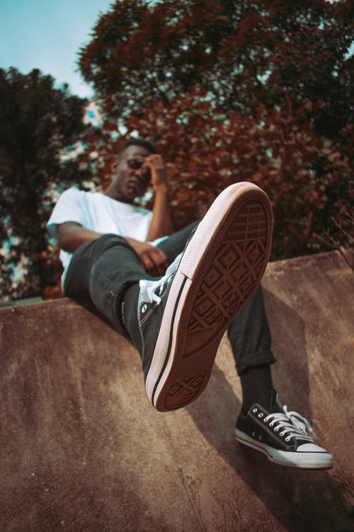 Man Wearing Black Low Top Sneakers