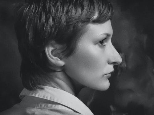 Grayscale Photography of Pixie-cut Woman Facing Side Ward