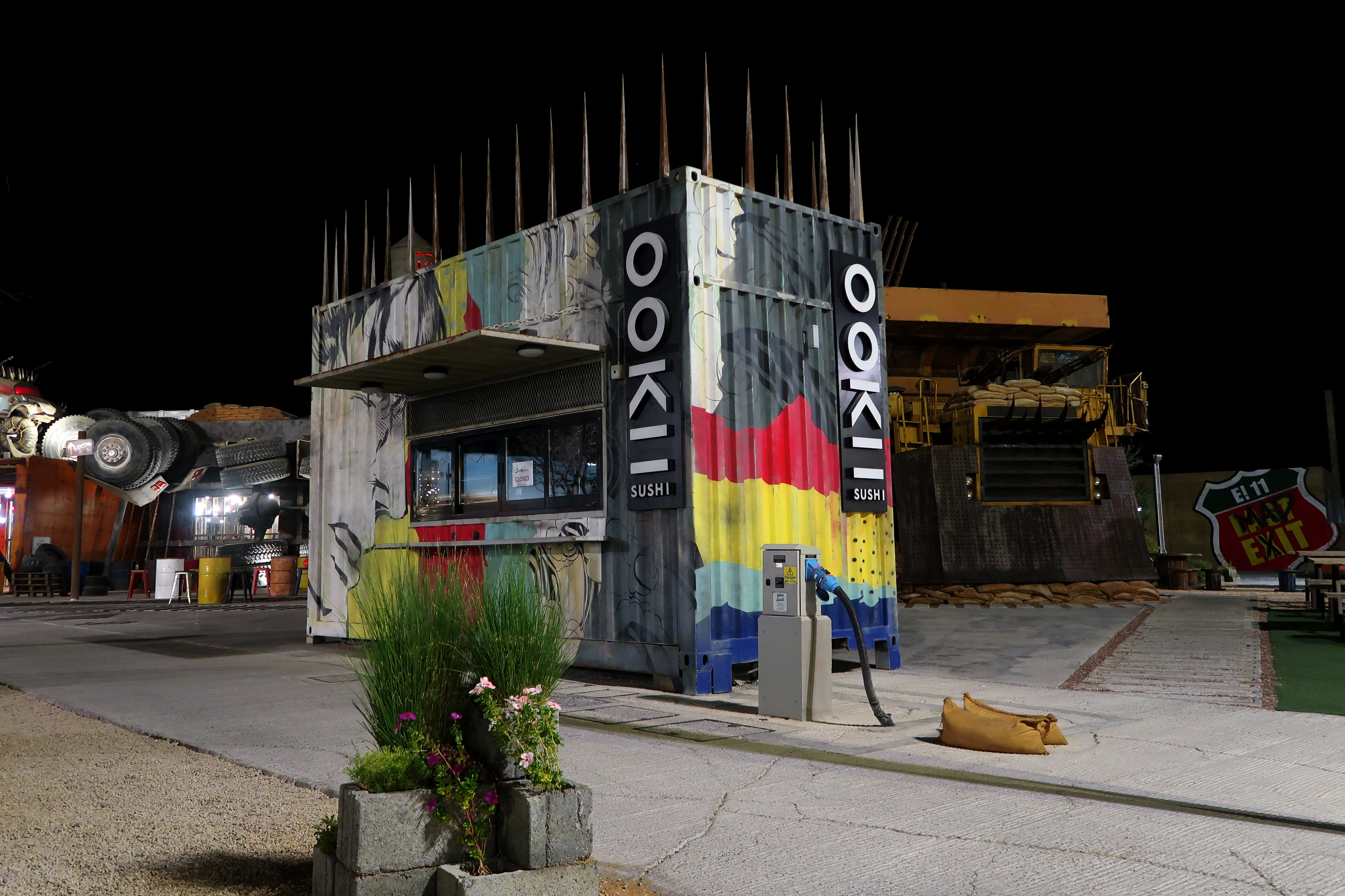 Free stock photo of colourful, designed shop, night, scrap behind the shop
