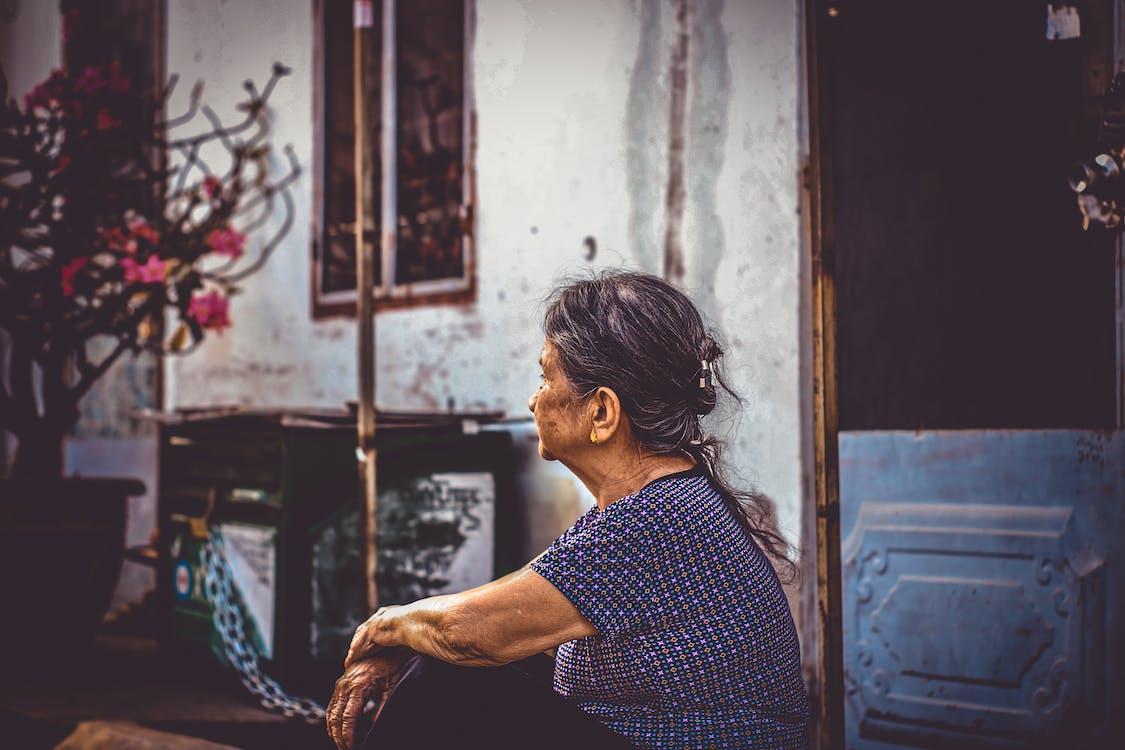 Woman Sitting Near Door