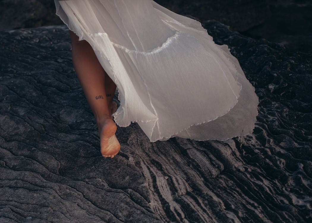 Woman Wearing White Dress Walking on Sand