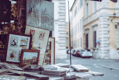 Photo Frames on Table Near Building and Road