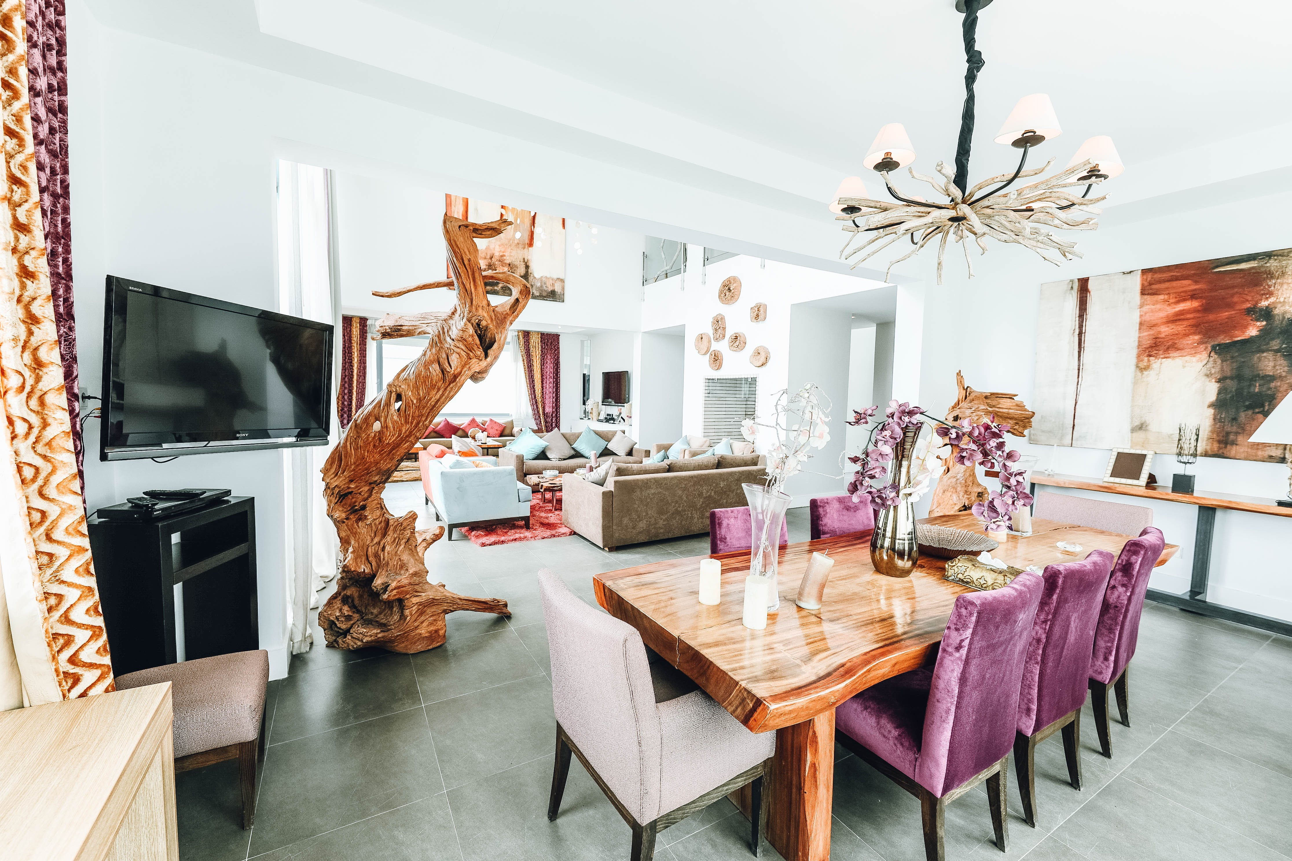 Brown Wooden Dining Set Near Television