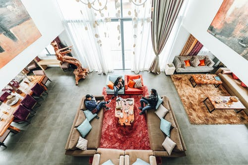 Aerial Photography of Three People Sitting on Sofa