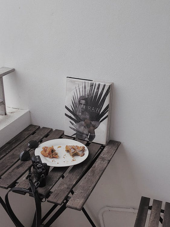 Food in Round White Ceramic Plate on Gray Wooden Table