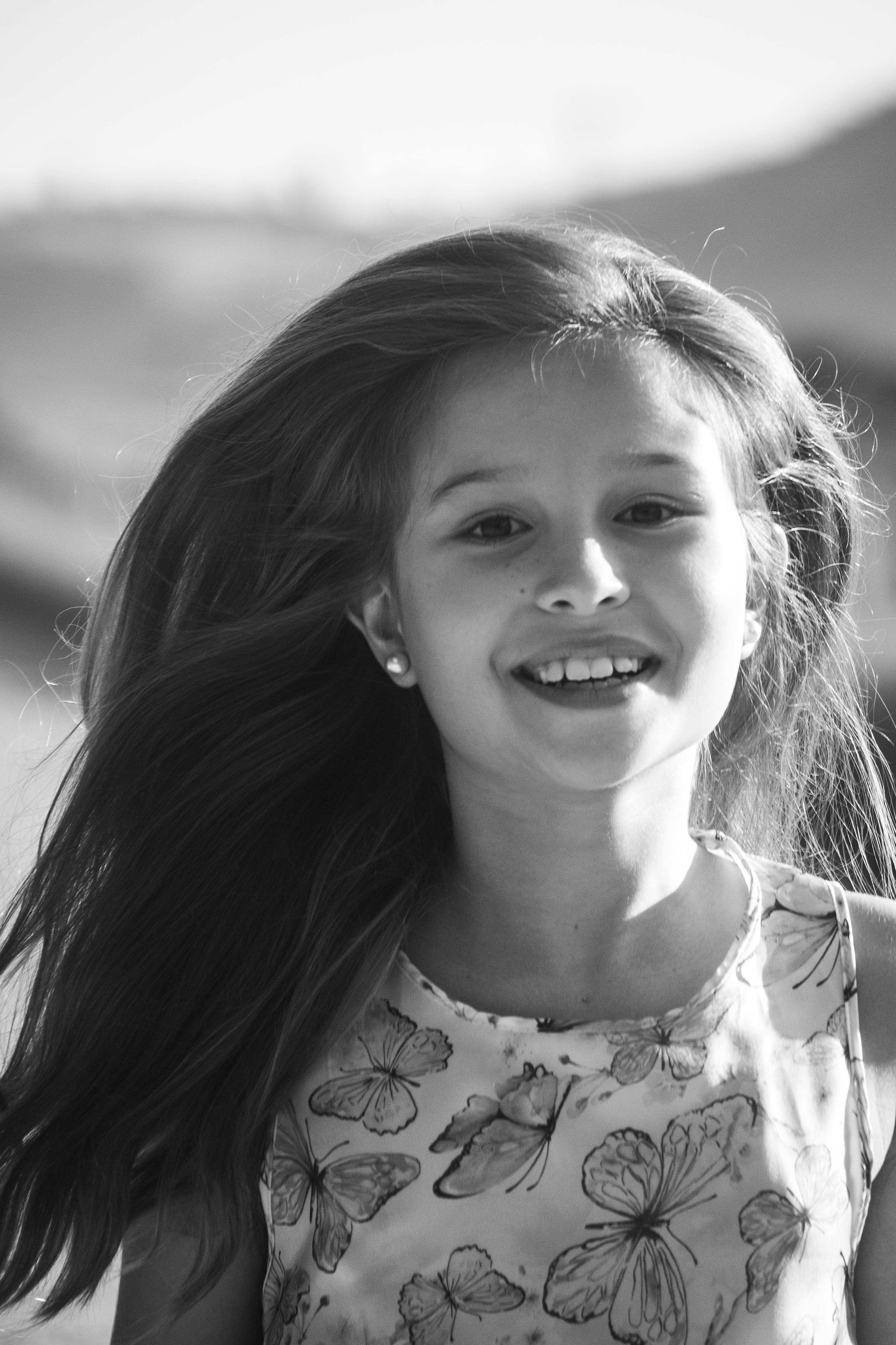 Monochrome Photo Of Girl Smiling