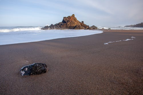 Black Rock on Sandy Beach