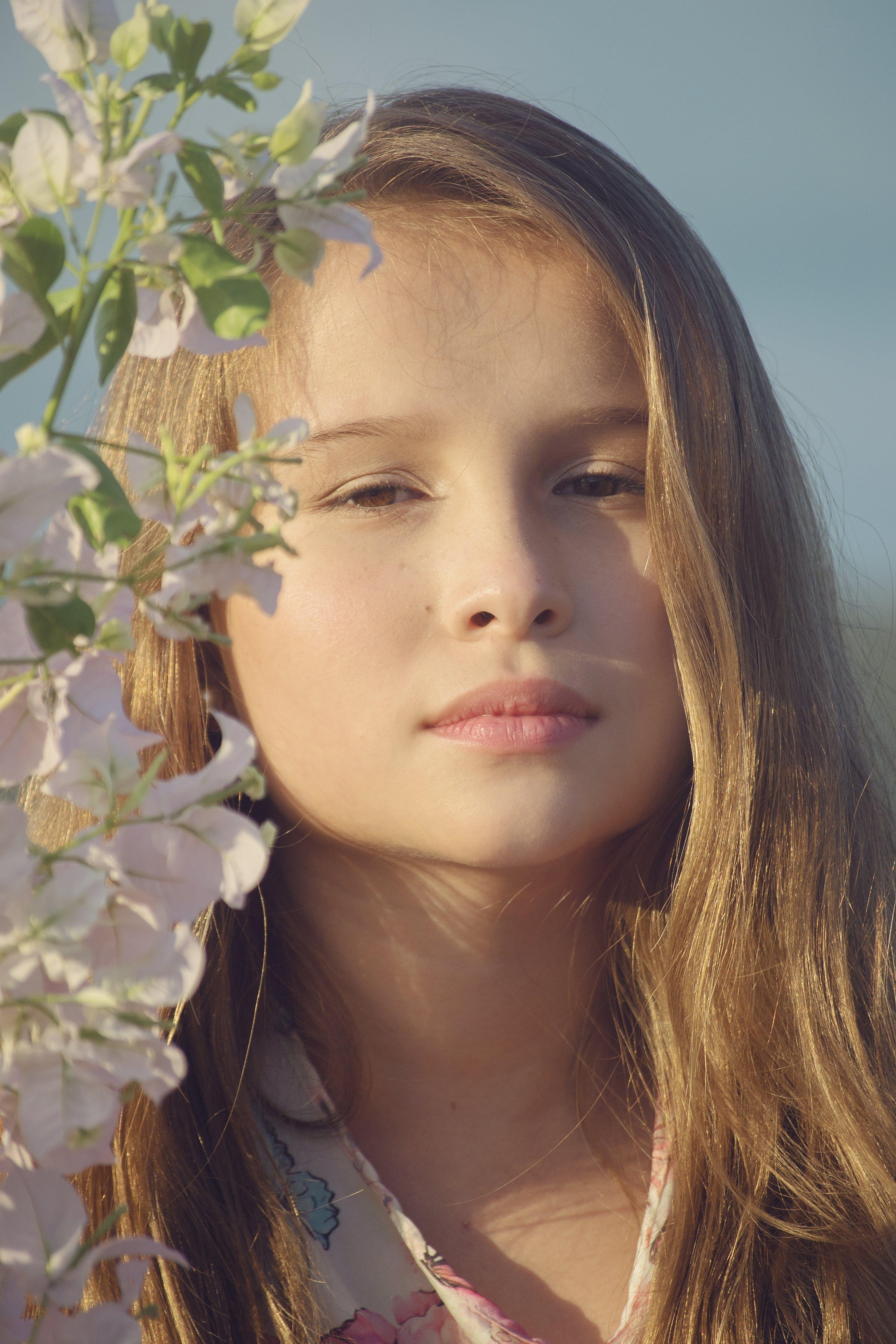 Woman Beside White-Petaled Flowers
