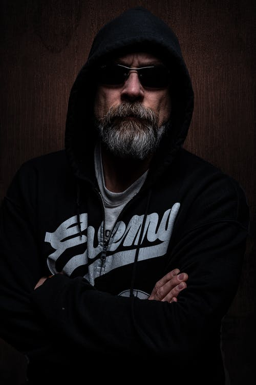 Man Wearing Black and White Hooded Jacket