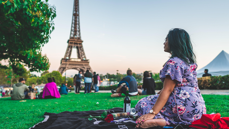 Woman Sitting Near the Eiffel Tower