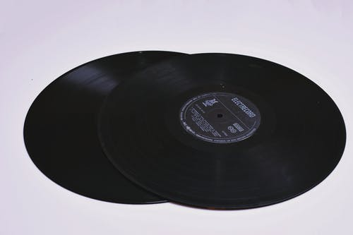 Close-up Photo of Two Black Lp Vinyl Discs