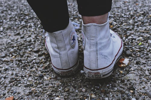 Close-Up Photo of Person Wearing White Converse