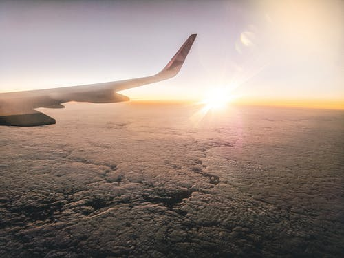 Free stock photo of airplane wing, clouds, flying, sunset