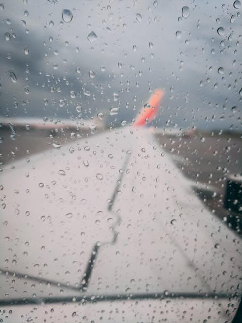 Free stock photo of aircraft wing, rain, southwest, storm