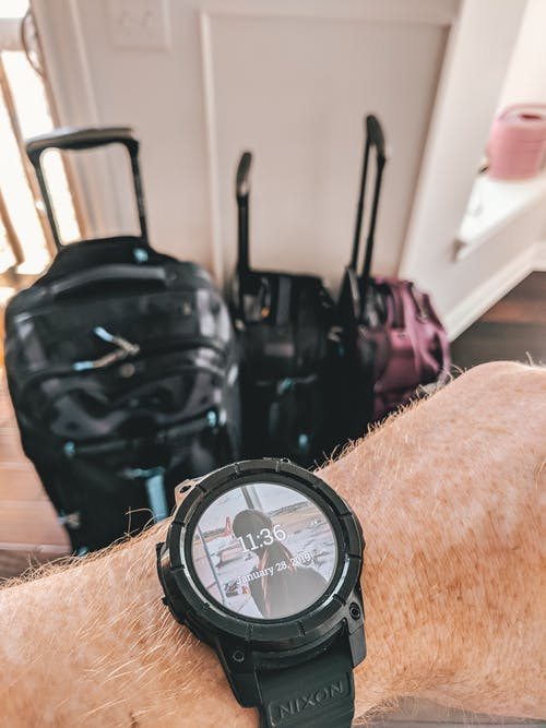 Free stock photo of hand, luggage, smartwatch