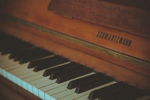 Selective Focus Photography of Brown Schwartzmann Piano