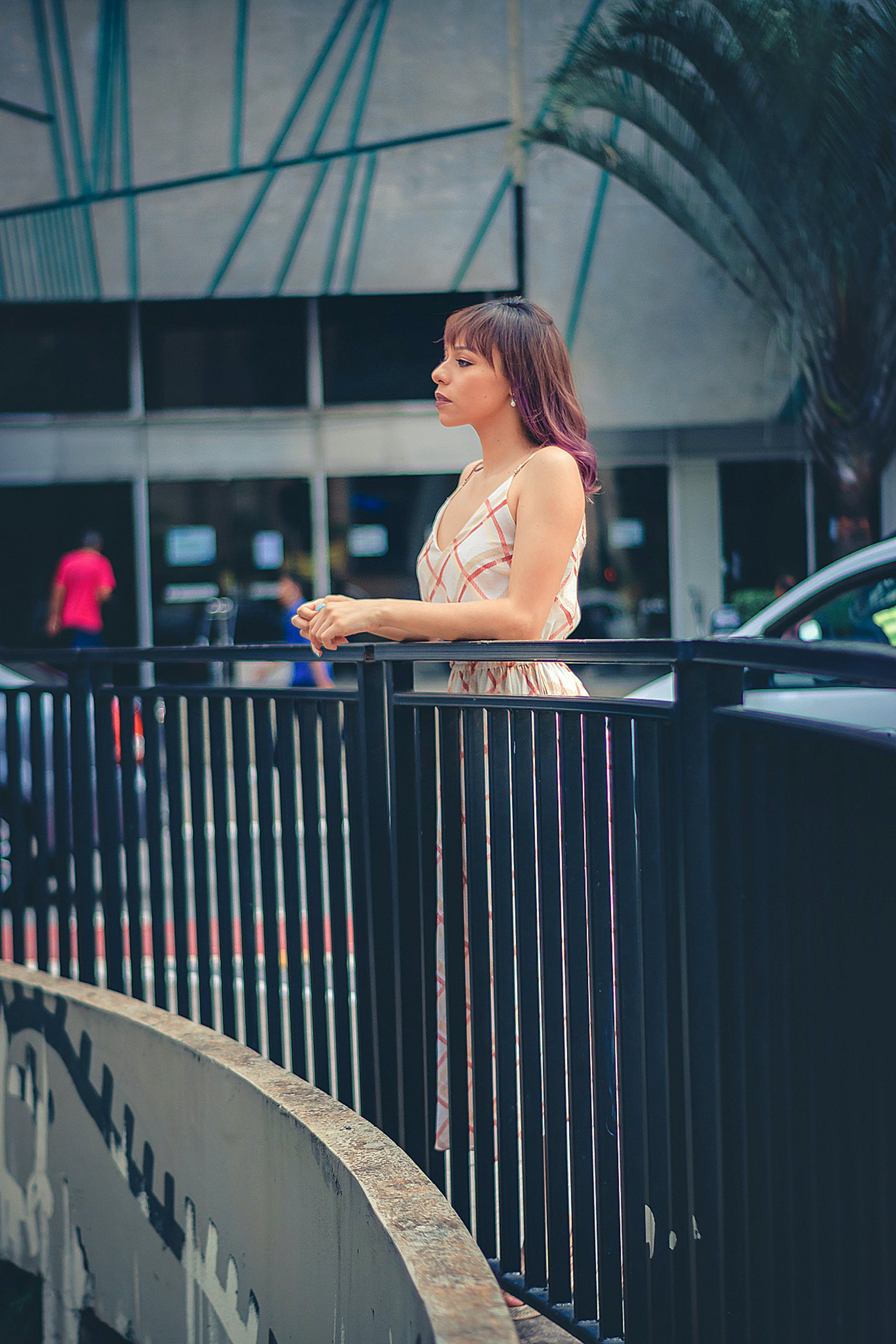 Woman Leaning on a Railing