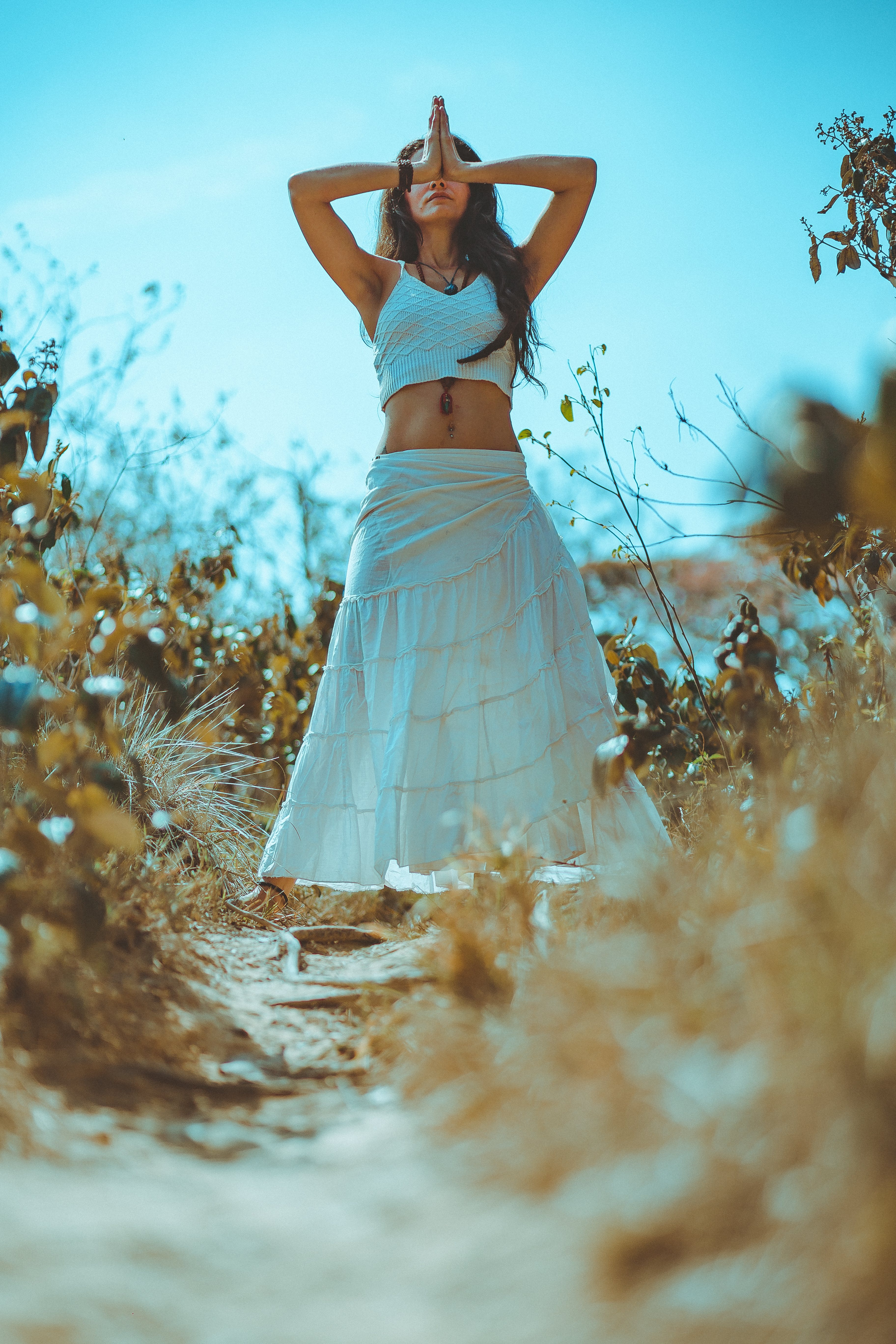 Woman in a White Top and Skirt
