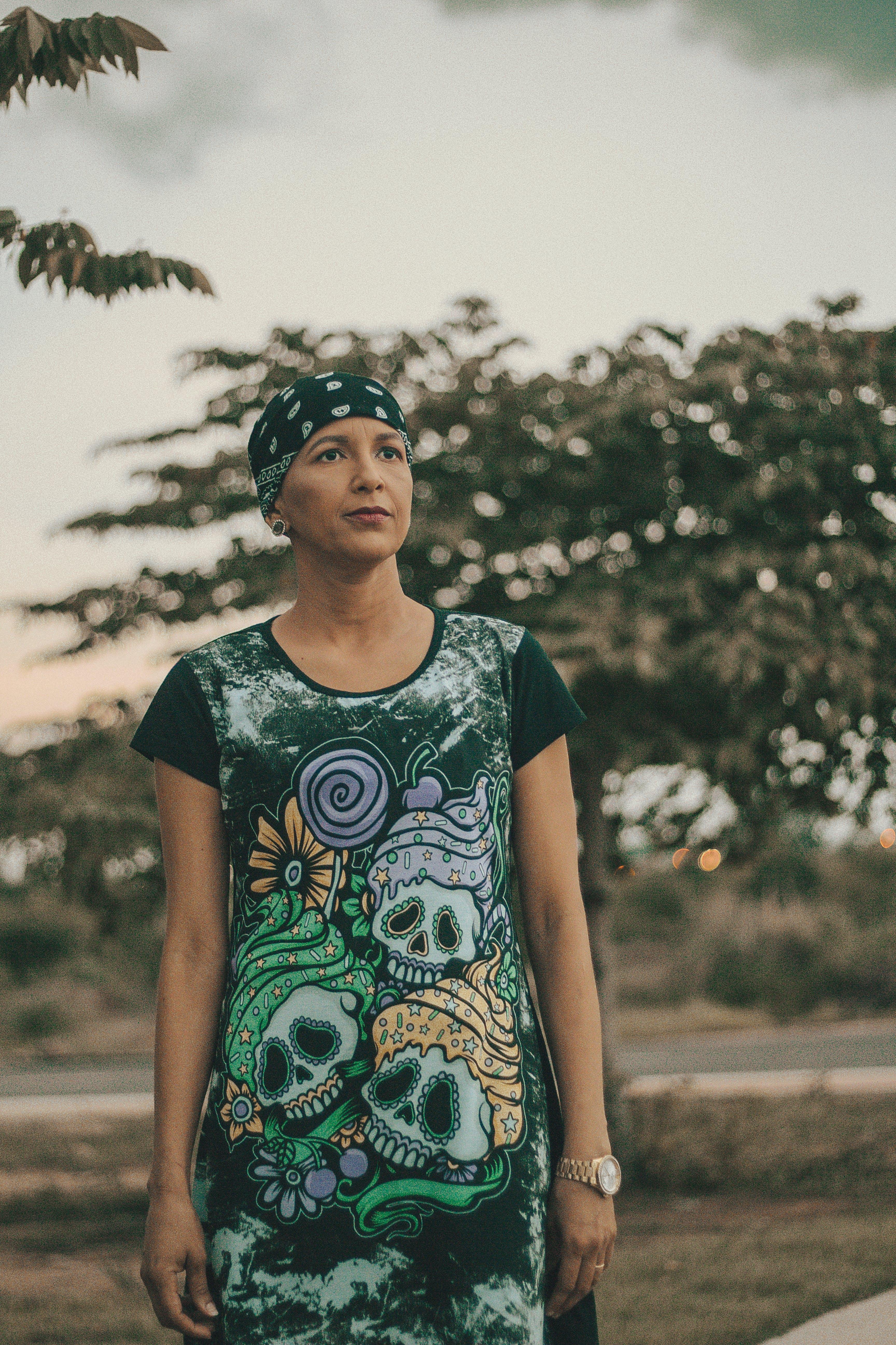 Woman Standing Near Green Trees