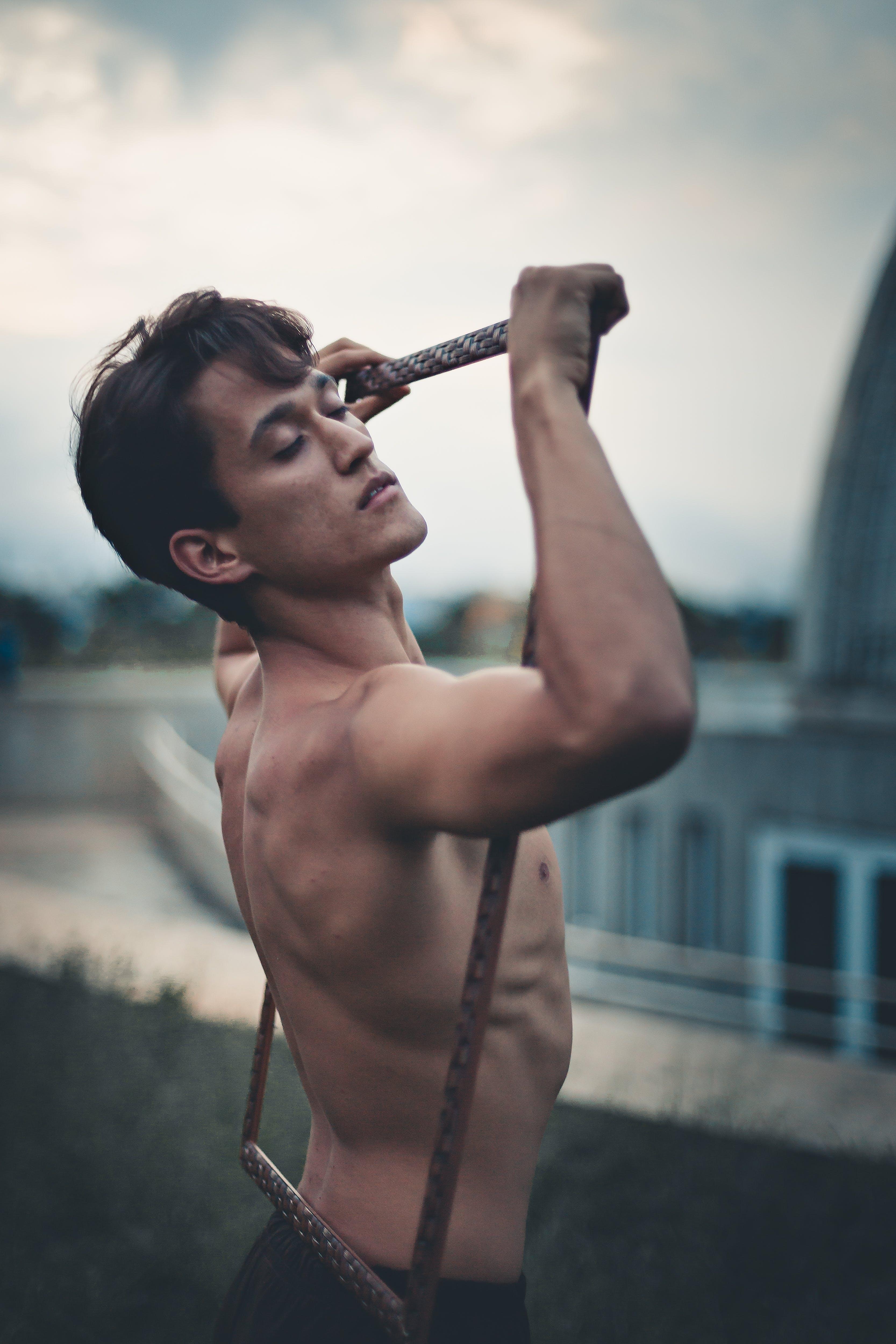 Topless Man Holding Frame