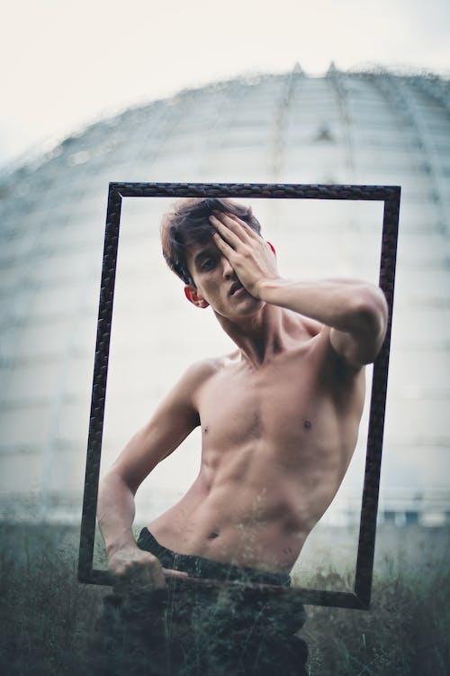 Безкоштовне стокове фото на тему «без сорочки, людина, модель, персона»