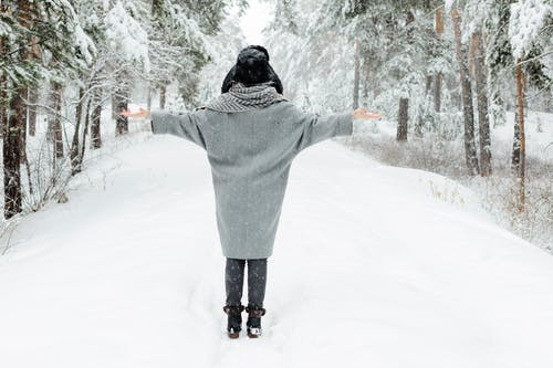Woman Wearing Gray Topcoat during Snow Season