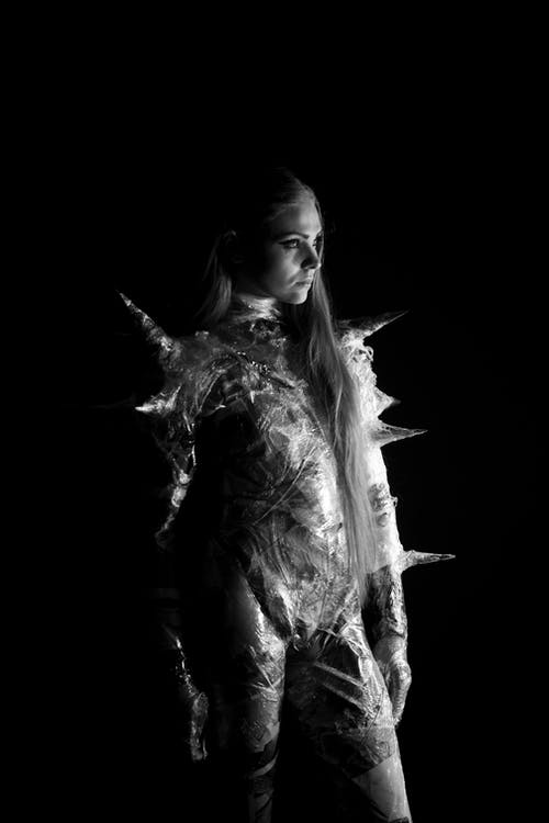 Woman Wearing Spiky Costume Grayscale Photo