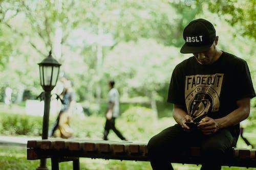 Foto profissional grátis de assento, homem, Indonésia, pessoa