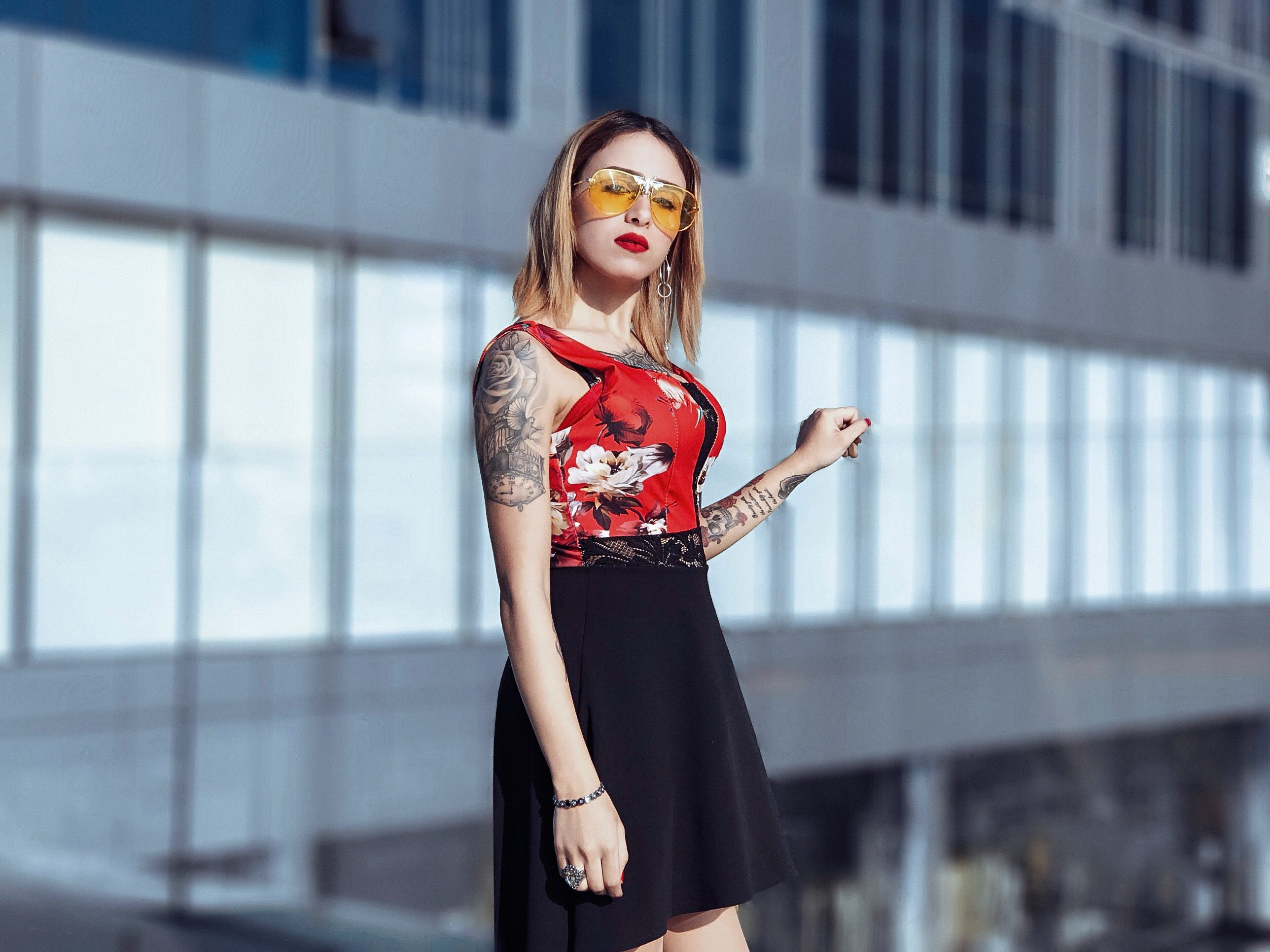 Woman In Red And Black Floral Sleeveless Dress
