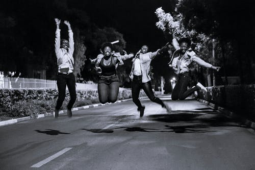 Group Of People Doing A Jump Shot