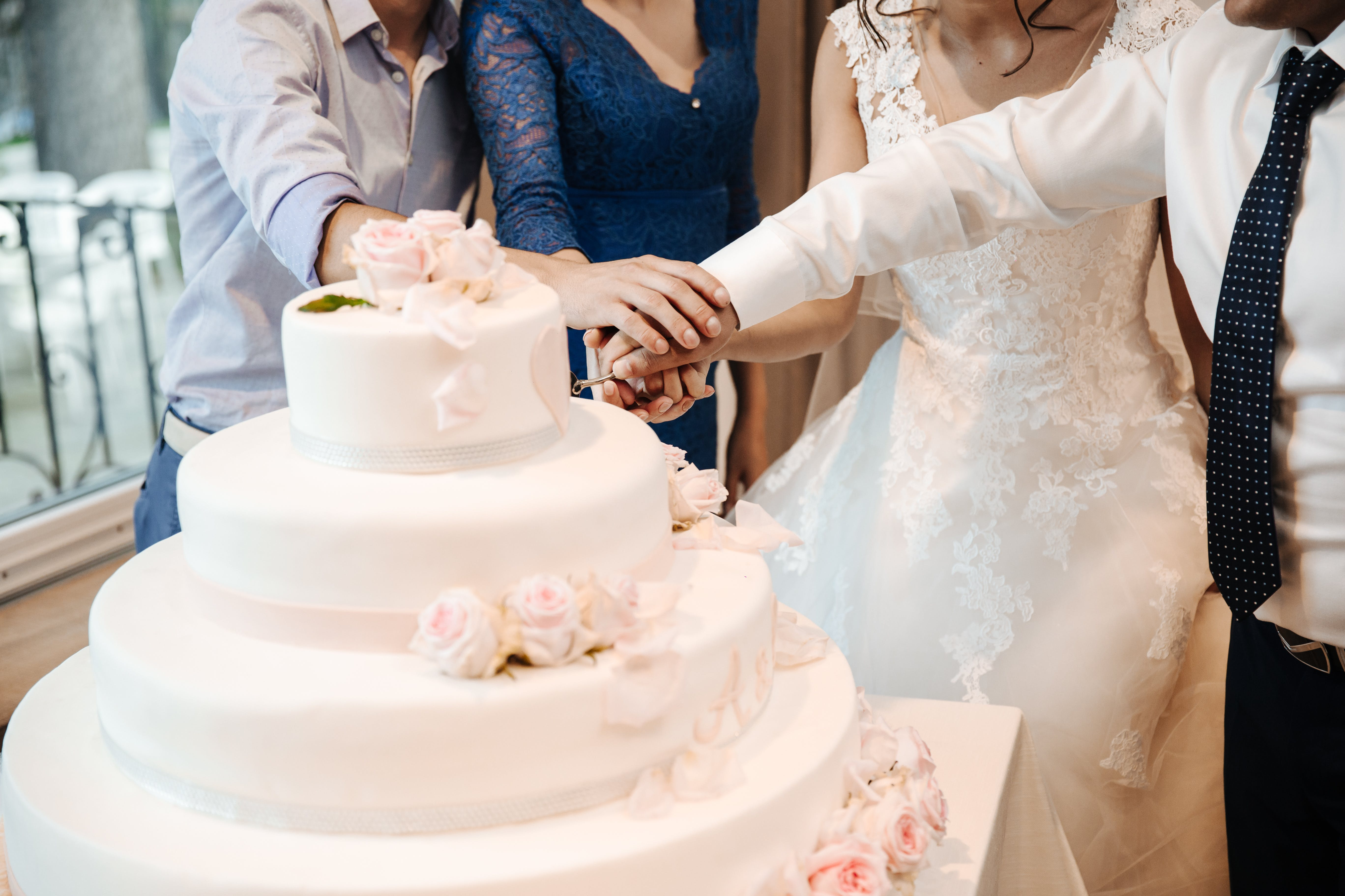 People Cutting Cake