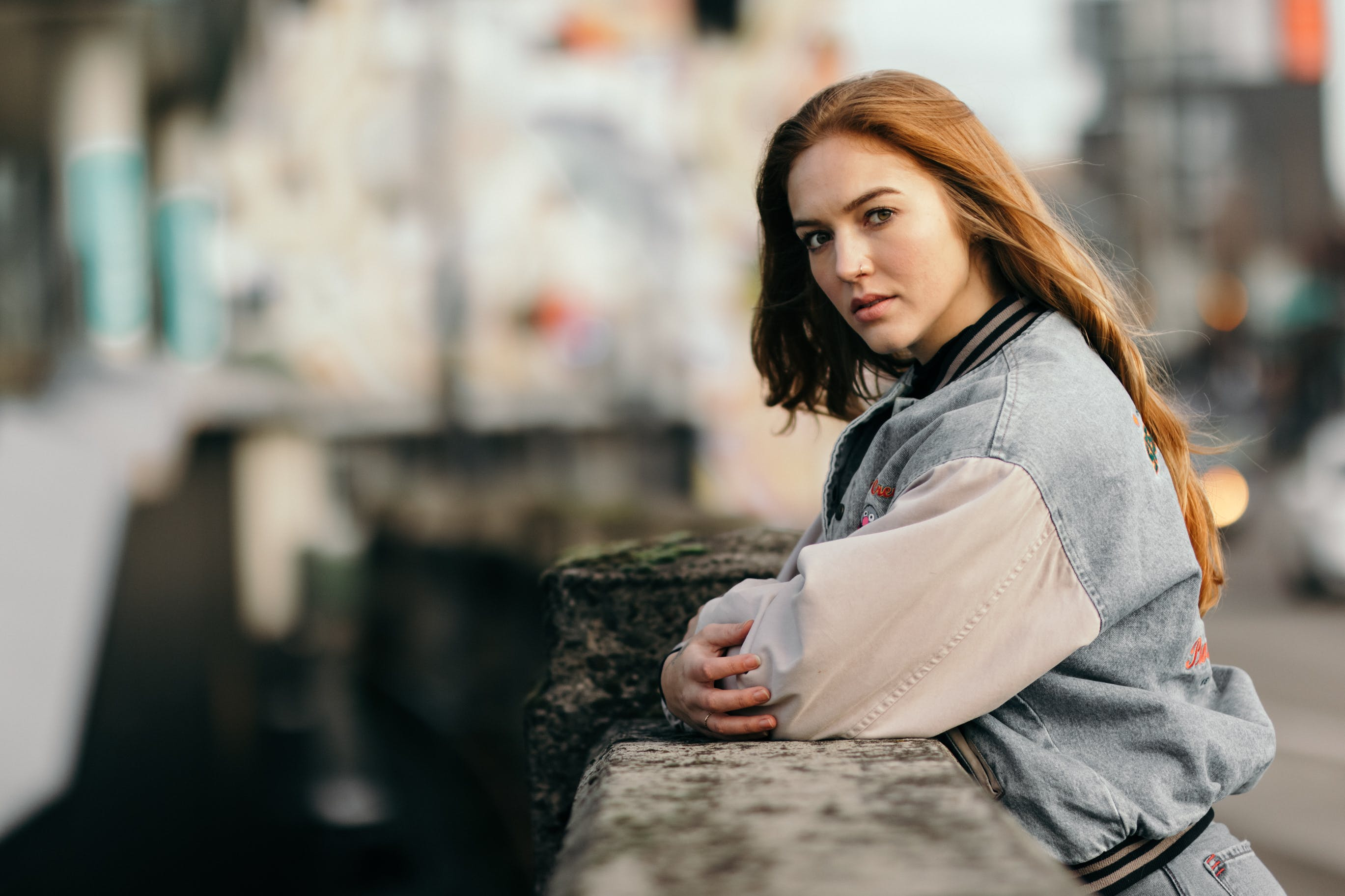 Woman Leaning On Concrete Fence